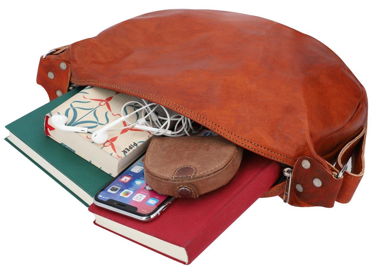 Outlet Handtasche - kleinere Lederfehler - kleine Farbunterschiede im Leder – Verfärbungen - faltige